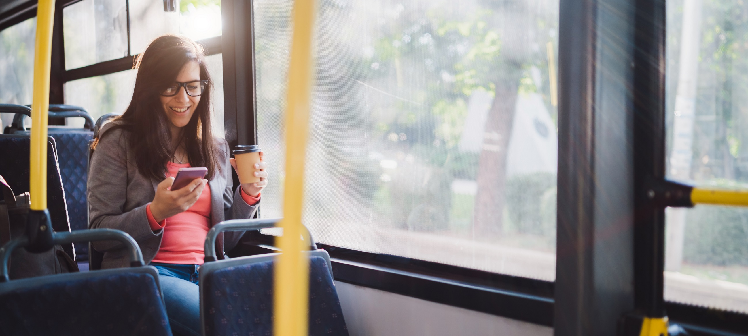 woman_bus_smartphone_coffee